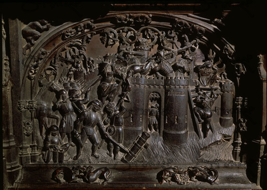 Wood Carvings Of Scenes Of The Conquest Of Granada On The Lower Choir Stalls In Toledo Cathedral